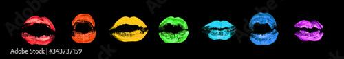 Fotografía Rainbow color lipstick kiss print set on black background isolated close up, col