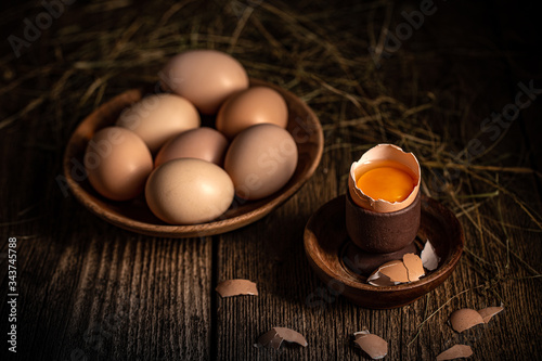 Whole and broken raw brown eggs Wallpaper Mural