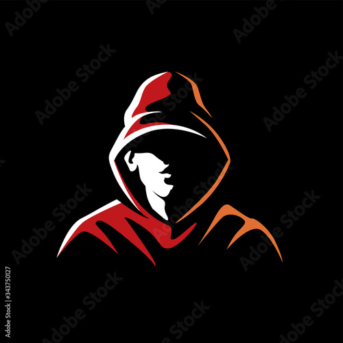 Fotografia Mysterious man in a hood on a dark background