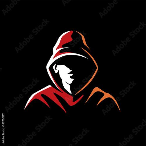 Fototapeta Mysterious man in a hood on a dark background
