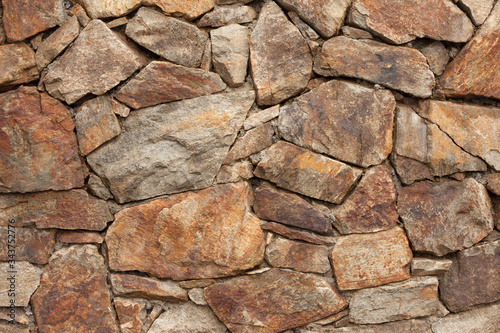 Fototapeta a wall built up with stones