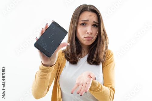 Fotografía Beautiful girl is upset about the broken phone