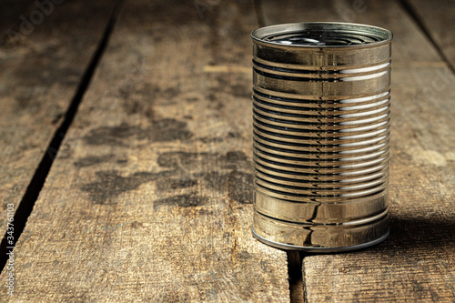 Tin cans with food on the table. Close up. Wallpaper Mural