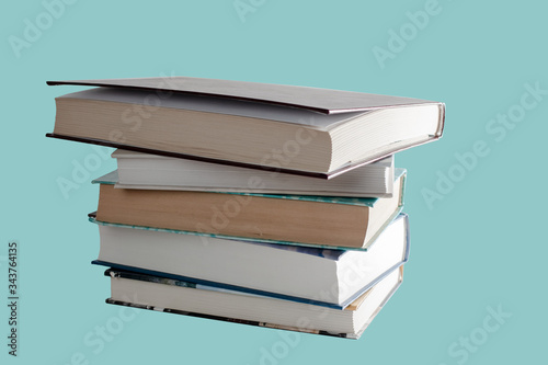 stack of various books isolated on light blue Slika na platnu