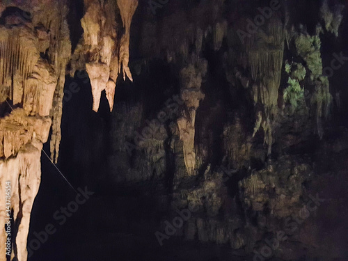 Limestone chalk stone cave inside water river brown light dark black green background cave pai tour chiang mai thailand