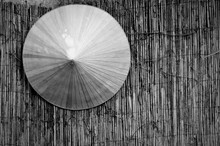Close-up View Of Asian Style Conical Hat On Table