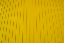 Bright Yellow Painted Wood Background