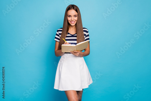 Fotografie, Obraz Photo of beautiful adorable lady hold diary copybook pen noting high school lect