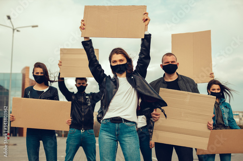 A group of people with mask and posters to protest The protest of the population against coronavirus and against the introduction of quarantine Meeting about coronavirus and people rights Fototapeta