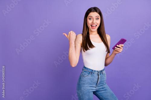 Portrait of astonished positive girl use smartphone search social media news ind Tapéta, Fotótapéta