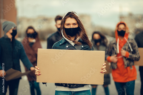 A group of people with mask and posters to protest The protest of the population against coronavirus and against the introduction of quarantine Meeting about coronavirus and people rights Canvas Print