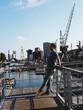 Man Standing On Bridge Over Sea In City