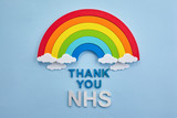 Fototapeta Tęcza - Thank you nhs rainbow banner. Rainbow ob blue background with letters