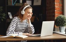 Excited Woman In Headphones Ha...