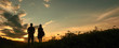 Silhouette Man And Woman Standing On Field At Sunset