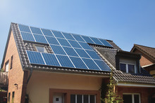 Rooftop Of House With Solar Panel System Installed. Sun Electricity. Efficient Way Of Getting Energy For Electricity And Water Heating.Green Energy For Living. Environment Saving Solution.