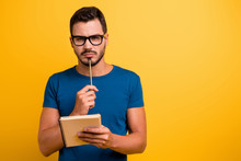 Close-up Portrait Of His He Nice Attractive Focused Concentrated Intelligent Guy Writing Notes Creating New Strategy Isolated Over Bright Vivid Shine Vibrant Yellow Color Background