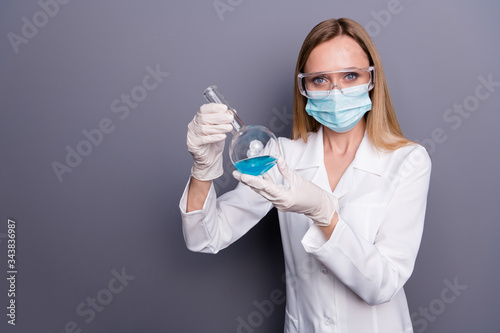 Portrait of nice attractive blonde girl qualified experienced doc holding in han Wallpaper Mural