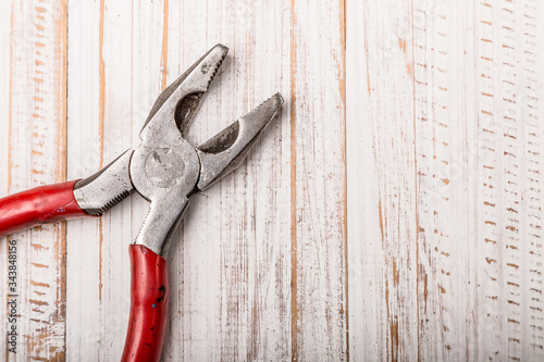 Pliers  hand tool isolated on white  wood top view Wallpaper Mural