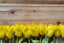 Yellow Tulips On Wood Table Ba...