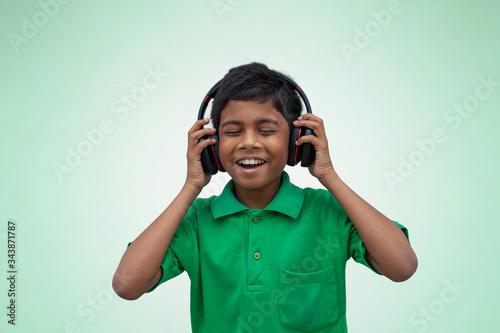 Fototapeta Boy Listening Music on the Smart Phone