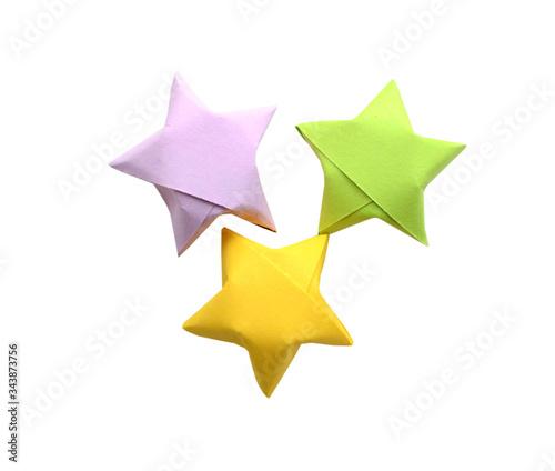 Obraz na plátně Colorful origami lucky stars isolated white