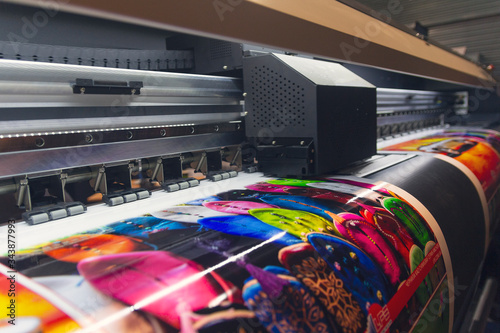 Valokuva Large format printing machine in operation. Industry