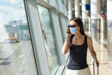 Young Tourist Woman With Bagga...