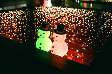 Inflatable Snowmen On Christmas Lights At Night