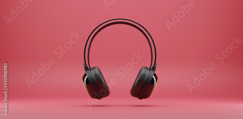 Fotografia, Obraz black music headphones isolated on pink background. 3d rendering.