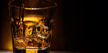 Whiskey Is Poured Into A Glass...