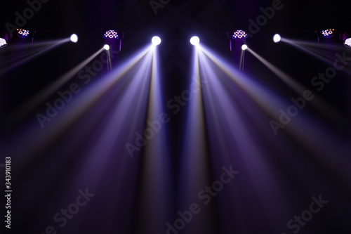Fototapeta Theater lights spotlights over the stage, texture background for design