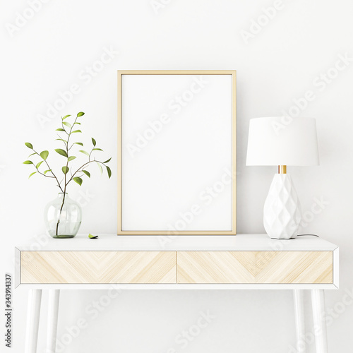 Obraz Interior poster mockup with vertical gold metal frame on the console table with green tree branch in vase and  lamp on empty white wall background. A4, A3 size format. 3D rendering, illustration. - fototapety do salonu