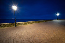 View From The Boulevard With Illuminated Street Lamp During The Blue Hour, Urk Netherlands