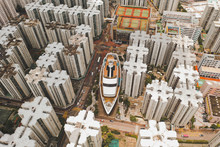 Aerial View Of A Boat Shopping Mall With Symmetrical Apartment Blocks  In WanChai, Hong Kong.