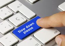 Slow Down Please - Inscription On Blue Keyboard Key.