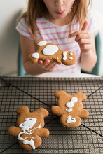 Girl Eating Gingerbread Man