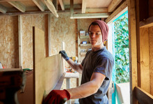 Carpenter Working In Shed With...