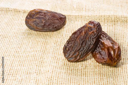 Fényképezés Big luxury dried date fruit on a linen napkin, kurma ramadan kareem concept, close up
