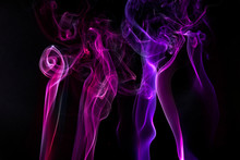 Multi Colored Smoke Against Black Background
