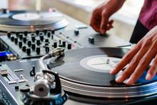 Male DJ On Turntable Spinning Vinyl Records
