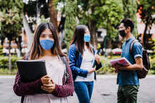 Mexican Girl Student Wearing Mask Face To Prevent Infection Or Respiratory Illness, Latin People With Protection Against Contagious Coronavirus In Mexico Or Latin America