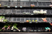 An Almost Sold Out Produce Section Of A Market Due To Coronavirus.