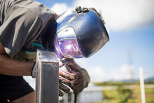 Close Up View Of Man Welding O...