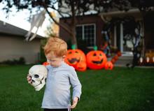 Toddler Holding Skeleton Head ...