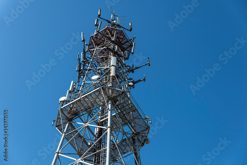 Photo Cellular radio tower, antenna used for mobile phones telecommunications
