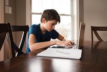Tween Boy Working On His Homew...