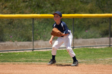 Little League Baseball Infielder Ready For A Ground Ball