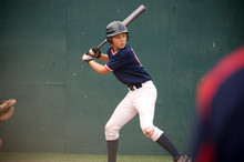 Young Baseball Player In Batte...