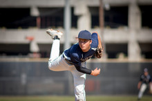 Teen Baseball Player Pitcher In Blue Uniform On The Mound